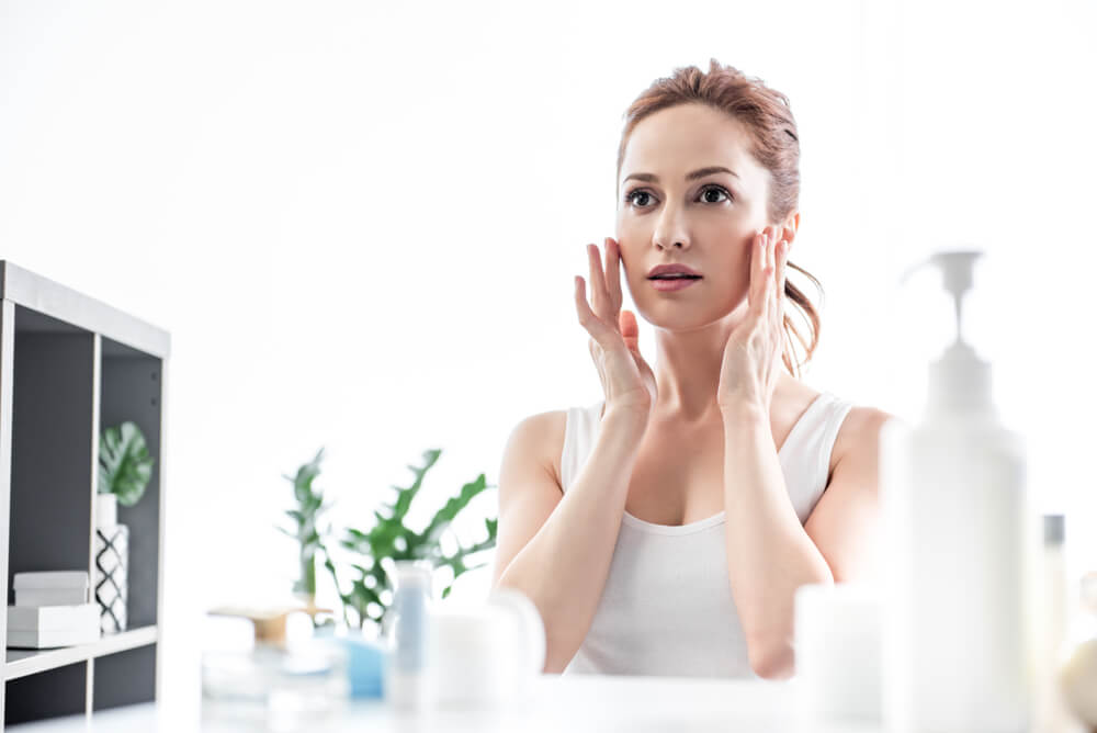 Woman massaging face for circulation boost