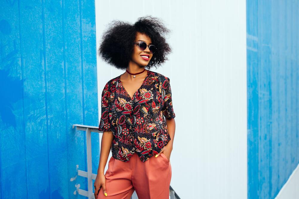 Fashionable woman in print blouse and orange-brown slacks