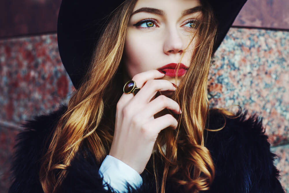 Beautiful fashionable woman in hat