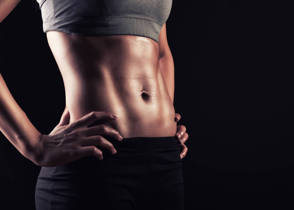 Closeup of woman's flat abs