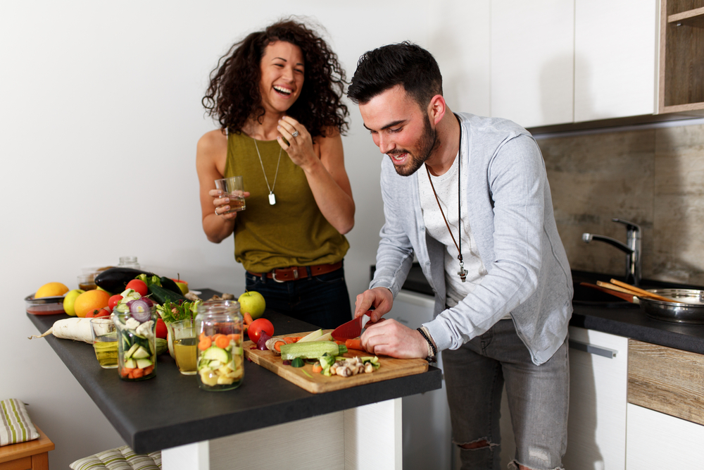 Young couple making a healthy meal in the kitchen