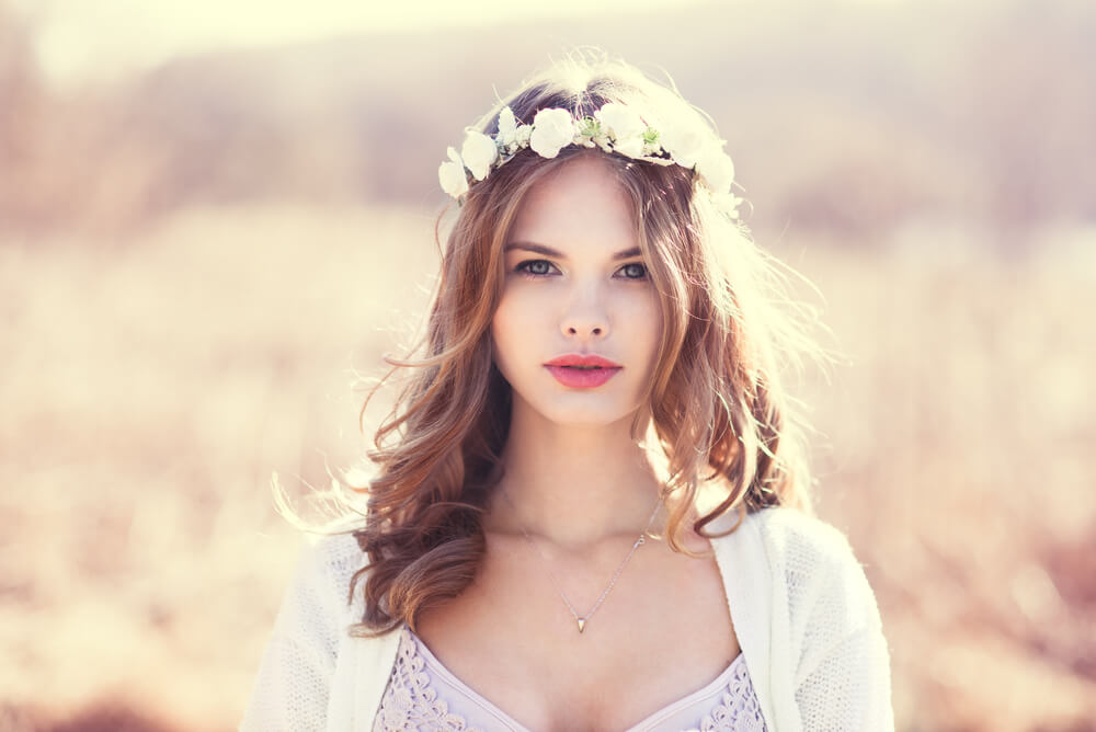 Pretty young woman with flower garland in her hair