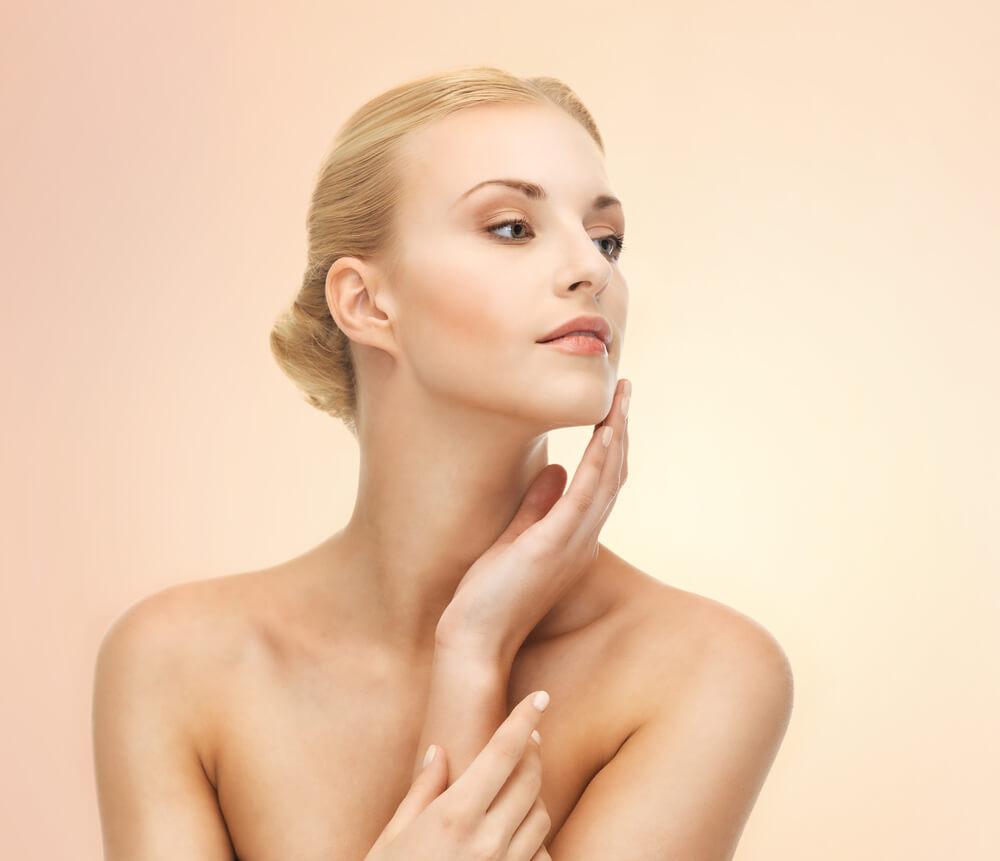 Young woman touching skin