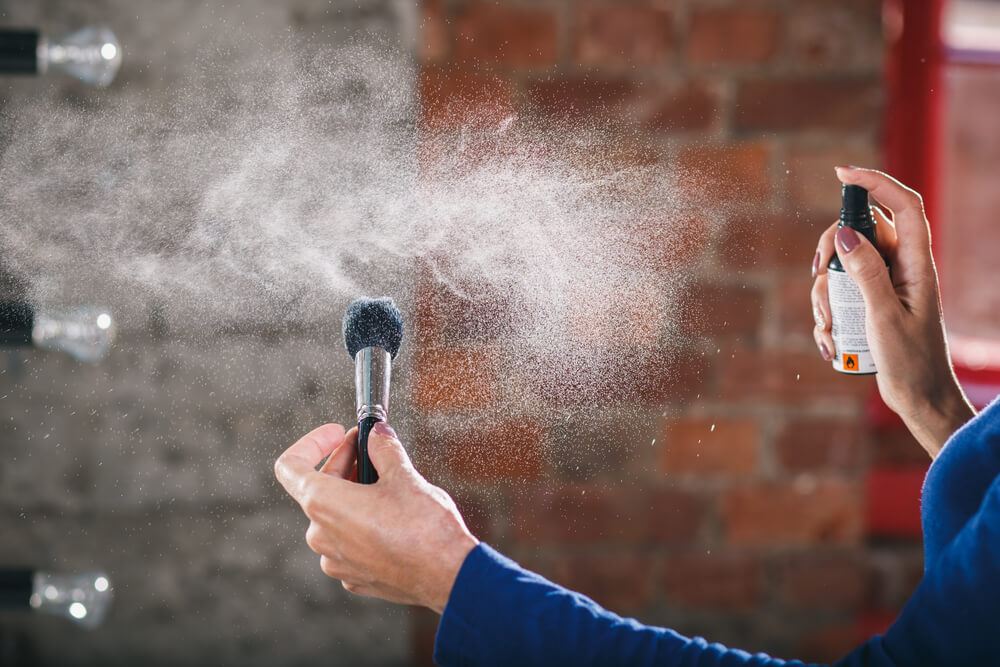 Spraying water on makeup brush