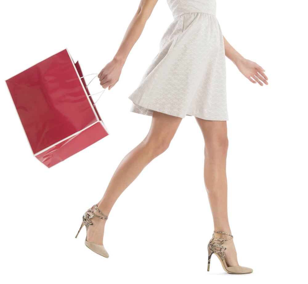 Woman in heels with red shopping bad