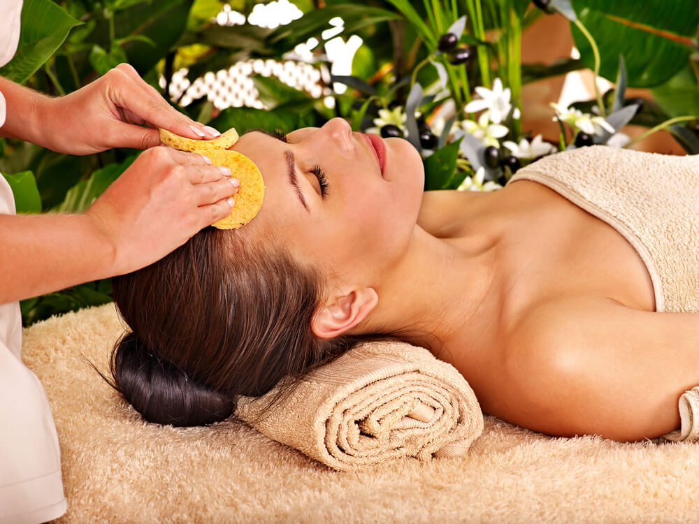 Woman enjoying a facial treatment in the spa
