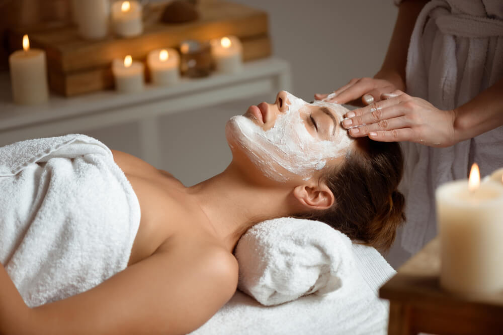 Woman enjoying facial treatment at the spa