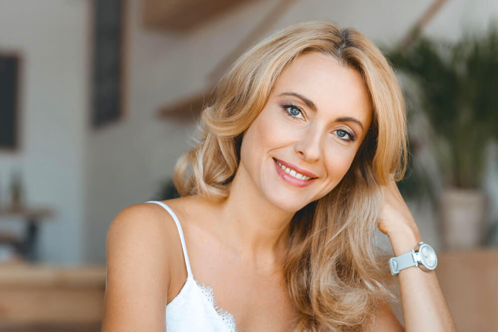 Beautiful blonde middle-age woman smiling