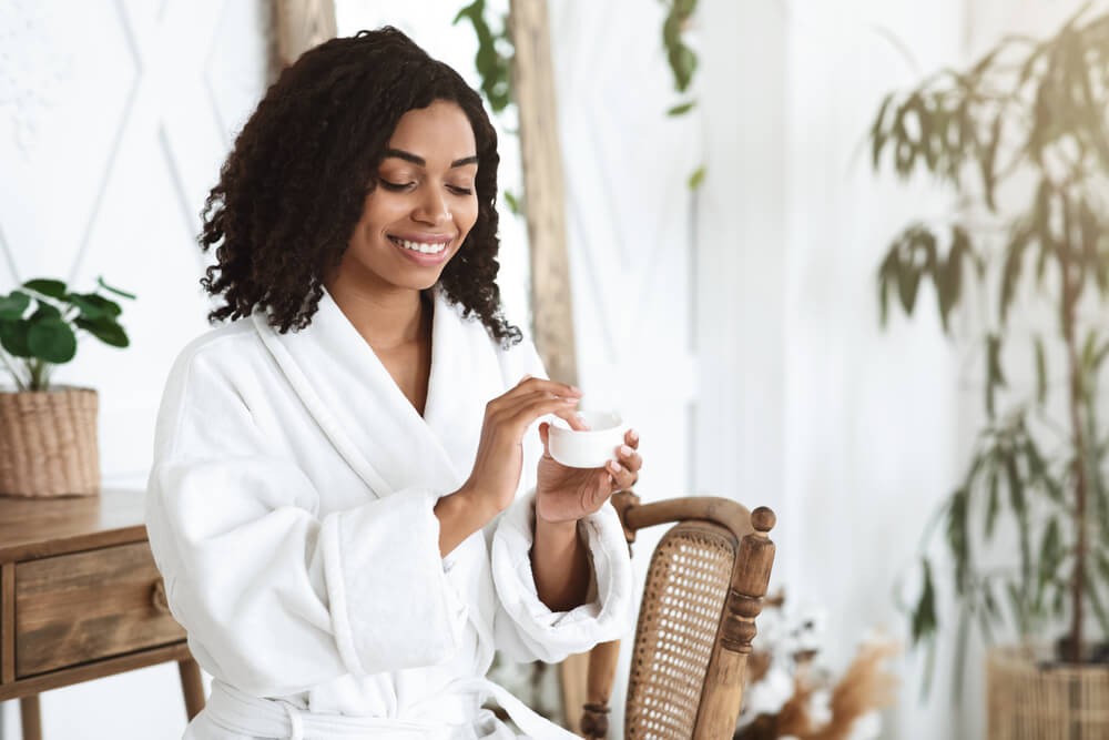 Woman using moisturizer