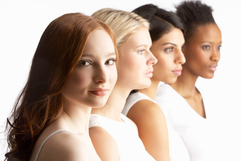 Multi-ethnic women lined up in a row